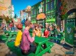 Скриншот Planet Coaster № 4. Люди, отдыхающие в кафе, которое появилось в одном из дополнений